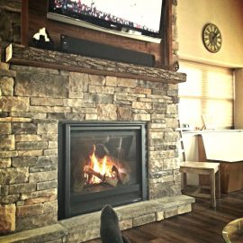 Fireplace and TV at our Ozark lodge